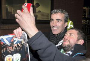 Former Donegal football manager Jim McGuinness takes a photo with a fan at the match last night. Photo: Mark Condren