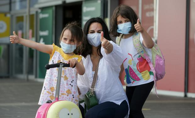Return of non essential international travel Dublin Airport. Valentina Crispo with her daughters Sophie (4) and Zoe (7) heading to Bari in Italy. Picture; Gerry Mooney