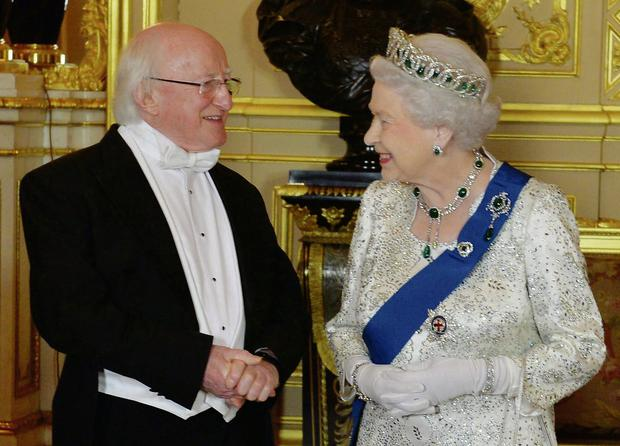 President Michael D Higgins in conversation with Queen Elizabeth before the historic state banquet in Windsor Castle.