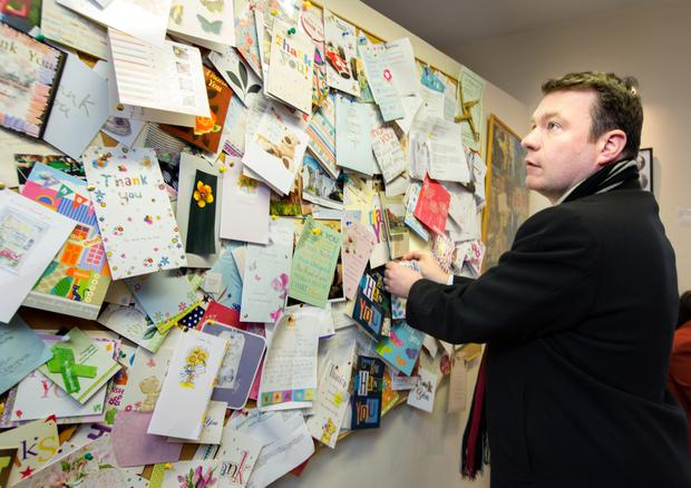 Minister of Environment, Community & Local Government Alan Kelly with some of the hundreds of thank you cards in his constituency office in Nenagh, Co. Tipperary last Friday.