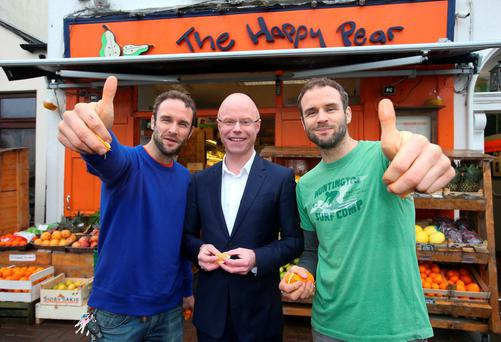 Stephen Donnelly with David and Stephen Flynn from The Happy Pear in Greystones, Co Wicklow. Photo: Damien Eagers
