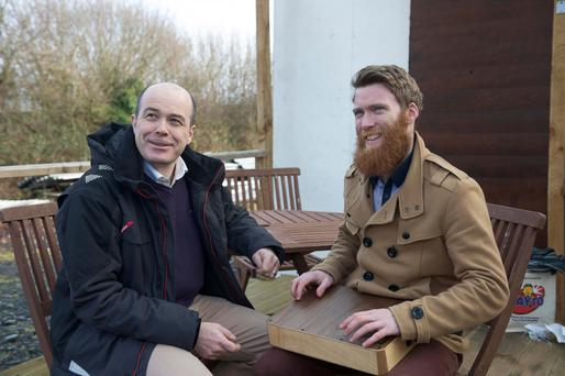 Denis Naughten speaks to drum maker Lorcan Mitchell of Anam Ceol. Photo: Andrew Downes