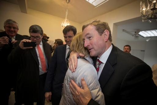 An impromptu hug on the campaign trail. Photo: Mark Condren.