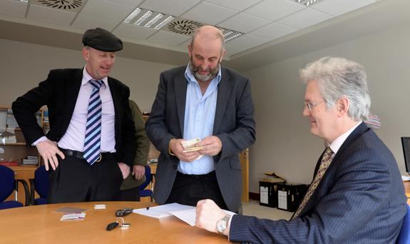 Danny Healy-Rae with his brother Michael hands in his nomination papers to Registrar Padraig Burke. Photo: Don MacMonagle