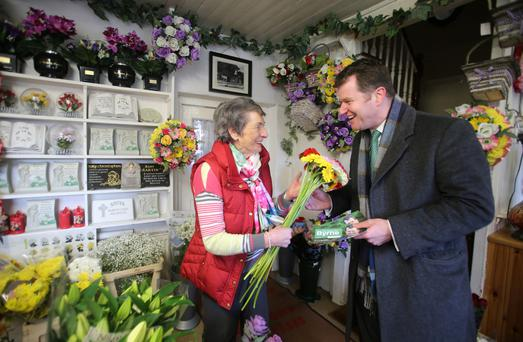 Cllr Malcolm Byrne canvassing at Gorey, Co Wexford, with local florist Peg Gibbons. Photo: Patrick Browne