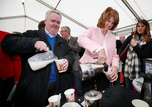 Tánaiste Joan Burton and Willie Penrose pour themselves a cup of tea in the Labour Party Tent at the National Ploughing Championships. Photo: Frank McGrath