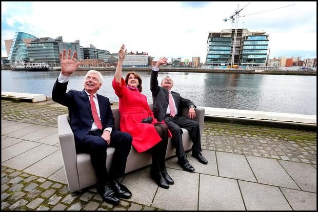 Communications Minister Alex White; Tánaiste and Labour leader Joan Burton; and Minister for Public Expenditure and Reform Brendan Howlin outside their election headquarters on Sir John Rogersons Quay yesterday. Photo: Steve Humphreys
