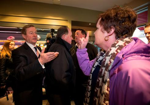 Enda Kenny is confronted by a woman while canvassing in Trim last night. Photo: Mark Condren