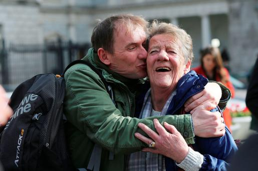People Before Profit TD Gino Kenny hugs his mother Marie. Photo: PA