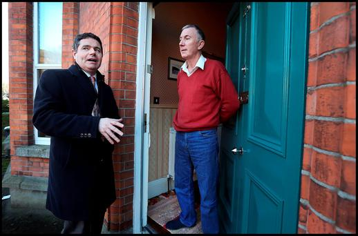 Paschal Donohoe canvassing Pearse Buckley in the Grangegorman area of his constituency. Photo: Steve Humphreys