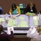 HARD AT IT: Votes are counted in the Longford-Westmeath by-election. Photo: Damien Eagers