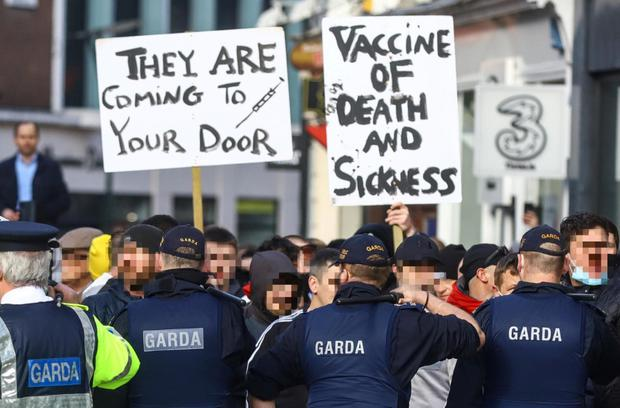 Garda public order personnel form a line on Grafton Street after disorder erupted at a planned anti-lockdown gathering in Dublin city centre on Saturday