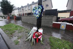 Floral tributes on Cherry Orchard Avenue, Ballyfermot, Dublin, where Warren Kenny died in a motorbike accident. Photos: Stephen Collins