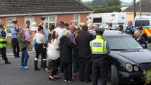 Family and friends grieve the remains of twin brothers leaving their home in Chaleville north Cork