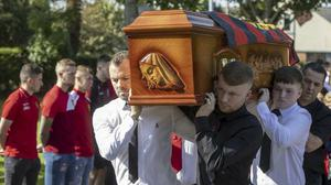The coffin of David Conroy is carried into the Sacred Heart Church, Laytown, Co. Meath. PIC: Conor O'Mearain / Collins