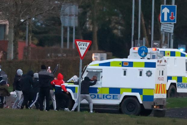 Youths attack a PSNI vehicle in the Nationalist area of Shantallow, Derry, following the discovery of a suspicious package near Templemore Road. Picture: PA