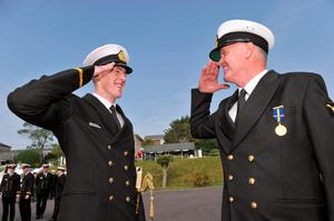Pictured at the Irish Naval Service Officer Commissioning Ceremony Haulbowline, Cork last September newly commissioned officer Philip Molloy from Cobh receiving a salute from his father CPO Thomas Molloy - joining the Navy is an option for young graduates.