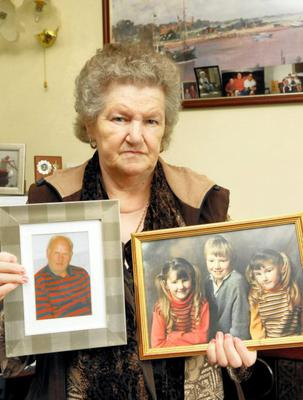 Memories: Anne Boyle, Mary's mother, holds photos of her late husband Charlie, and Mary. Photo: Jason McGarrigle