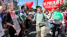 Pro life marchers pass Pro Choice protestors on O'Connell Street during campaigning ahead of last year's abortion referendum