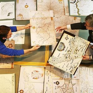 Dr Micheal O Siochru, Associate Professor of Modern History at Trinity College Dublin (right) and Dr Seamus Lawless with the 17th Century Down Survey of Ireland Map Collection