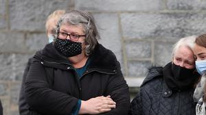 Anne O'Sullivan (centre) is consoled at the funeral of her son Mark in Kanturk, Co Cork, last October. Photo: David Conachy