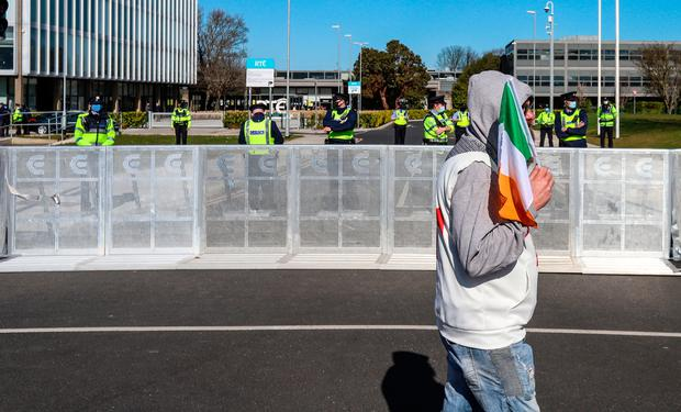 A protester outside RTÉ headquarters in Dublin is outnumbered by gardaíon Wednesday. Photo: Damian Storan/ PA