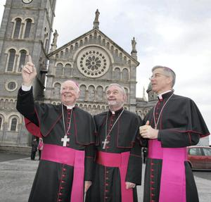 Archbishop Dermot Clifford  pointing out something to the newly appointed Archbishop of Cashel and Emly Bishop Kieran O' Reilly SMA (centre) and Papal Nuncio Archbishop Charles Brown