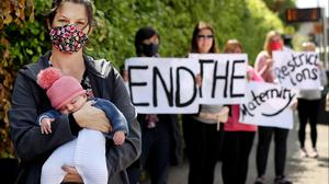 Shauna Gillan and her daughter Eabha Fallon (6 weeks) from South Circular Road who were amongst a group of parents representing the Association for the Improvements in the Maternity Services who staged a protest outside The Coombe Women and Infants University Hospital. Photo by Steve Humphreys