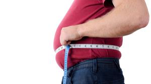 An expanding waistline could place you at greater risk of contracting a serious form of Covid. Photo: Rob Hyrons
