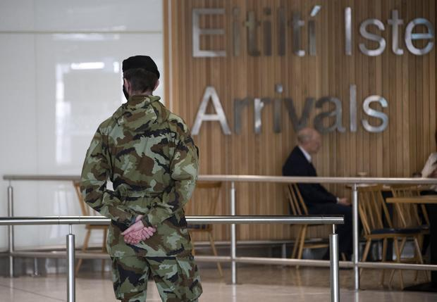 Members of the Defence Forces meet passengers arriving at Dublin Airport. Photo: Colin Keegan, Collins Dublin