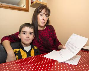 Roisin Whitty with her son Finlay and a letter she received from Health Minister Leo Varadkar. Photo: Thomas Nolan