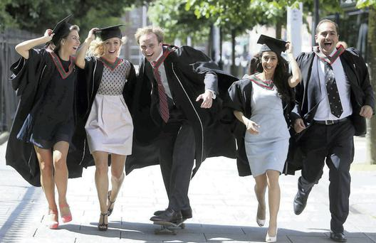 Graduates (from left) Ciara Nolan from Mount Merrion, Elaine Houlihan from Kildare, Michael Flanagan from Sandymount, Nasayem Alquraini and Elias Chamely from Trinidad.