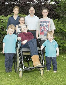 Jordan Egan with her family: (back row) Karen, Rebecca,Ted and Ross; (front row) Scott and Eli. Photo: Thomas Nolan.