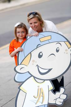 Rachel Churchill with her daughter Evie (6) from Sallins with Junior Arthritis mascot Jasper in Dublin yesterday. Photo: Conor McCabe Photography