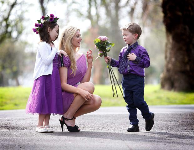RTÉ Fair City's Jenny Dixon, with Mia O'Neill, (6), who has cystic fibrosis, and her cousin Padraig Fay (4) at the launch of Cystic Fibrosis Ireland's 65 Roses national awareness week