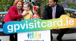Minister Kathleen Lynch and Minister Leo Varadkar, pictured with under six year old children Isabella Heapes age 3 and Kiya O'Connor age 4 from Macken Street, Dublin at the launch of the online registration system for the new Free GP Care for Children Under 6 service