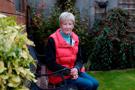 Cancer sufferer Mary Murphy pictured in the garden of her home in Kilcullen, Co Kildare. Below: Our Lady of Lourdes Hospital in Drogheda, where one patient's husband rang Liveline seeking information