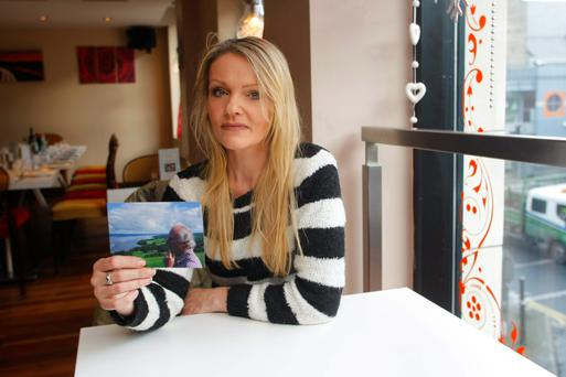 Joanne Moloney with a picture of her father Eddie (73). Photo: Marie McCallan/Press 22