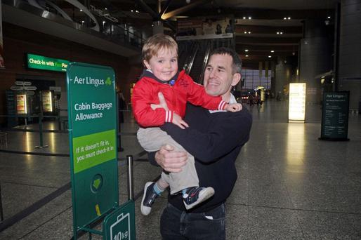 Surgery: Calum Geary with his father Andrew at Cork airport before flying to Manchester for auditory brainstem implants in 2012. Photo: Patrick Hogan/Provision