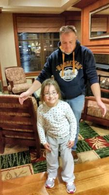 Katie Byrne (7) takes her first steps in St Louis under the proud but watchful eye of her father, Robert, after pioneering US surgery proved an outstanding success for her.