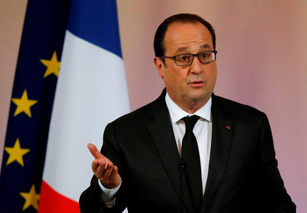 France's President Francois Hollande leaves a news conference on climate change for agricultural sector before the upcoming COP21 World Climate Summit