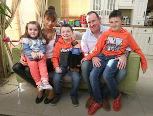 Fiona and Jason Byrne with their children, Dylan 7, Megan, 4, and Luca, 9, at their home in Swords.