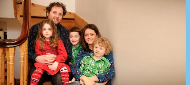 Tradtional background: Jennifer and Mark Ryan with their sons Zach (6), Noah (8) and Isabella (5) at their home in Ballinteer. Picture: Arthur Carron