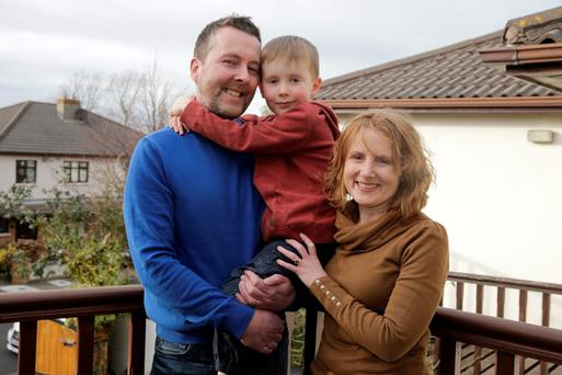 Claire Shiels and Eoin McCabe with their 6 year old son Josh at their home in Blackrock