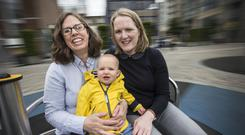 Waiting for change: Elaine Cohalan (right) and wife Jenny Synnott with their one-year-old daughter Cate. Photo by Colin O'Riordan