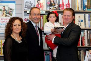 Michael Martin TD with Caroline and Niall O'Flaherty with their daughter Ava, at the launch of Baby Ava: An Irish Surrogacy Story at Dubray Books, Grafton Street. Picture: Arthur Carron/Collins