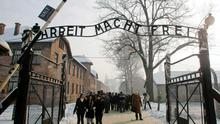 The words 'Arbeit Macht Frei' on the gates of the Nazi death camp at Auschwitz in Poland