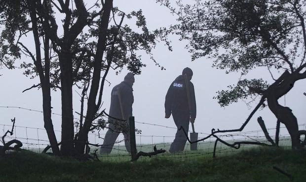 Gardai search a wooded area of Brewel East, on the Kildare/Wicklow border for the remains of Deirdre Jacob. Niall Carson/PA Wire