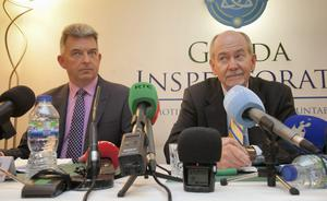 Mark Toland, Deputy Chief Inspector, and Robert K Olson, Chief Inspector, answer questions from the press after the publication of the Inspectorate's 10th report at the Office of the Garda Siochana Inspectorate on St Stephen's Green, Dublin, yesterday.