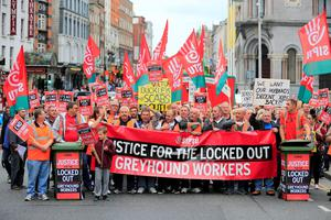 Workers march on City Hall to protest in support of the staff on strike at Greyhound Bins. Photo: Arthur Carron